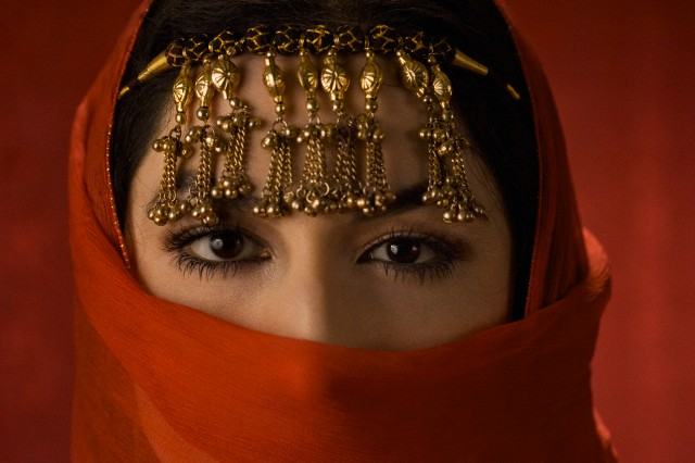 Middle Eastern woman in ornate headdress